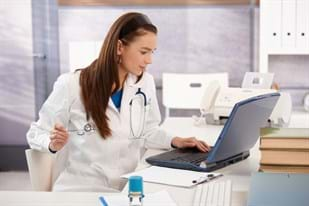 woman-doctor-using-tablet-computer-hospital-working-47202829